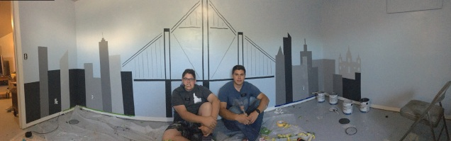 Elder Castellano and I painting the NYC skyline (with a temple) for a member family.